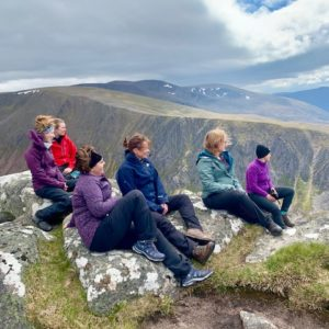 Women gaze over the mountain views high in the Cairngorms